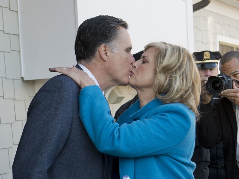 presidential candidate Mitt Romney and his wife Ann kiss after casting their votes in the US presidential elections in Belmont, Massachusetts, November 6, 2012. (Photo by Emmanuel Dunand/AFP/Getty Images)