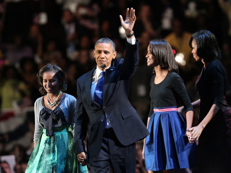 U.S. President Barack Obama walks on stage with first lady Michelle Obama and daughters Sasha and Malia to deliver his victory speech on election night at McCormick Place November 6, 2012 in Chicago, Illinois. Obama won reelection against Republican...