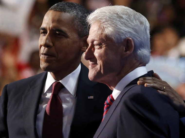 President Barack Obama embraces former President Bill Clinton onstage after Clinton nominated Obama for re-election during the second session of Democratic National Convention in Charlotte, N.C., September 5. (Photo: Reuters/Larry Downing)