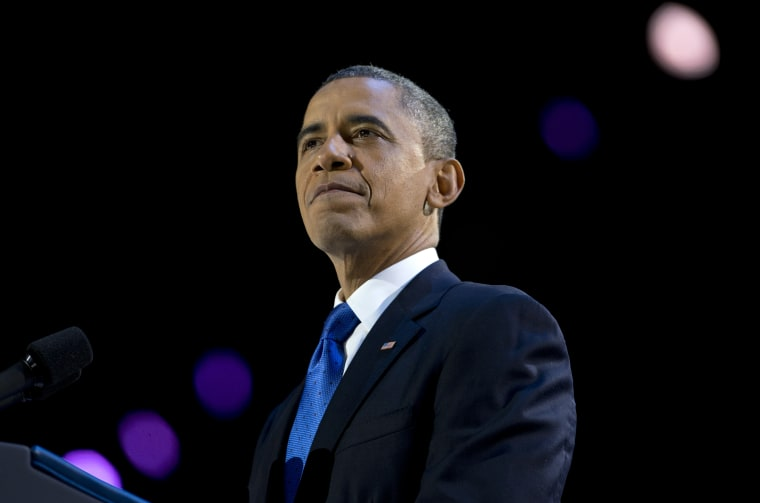 President Barack Obama pauses as he speaks at the election night party at McCormick Place. (AP Photo/Carolyn Kaster)