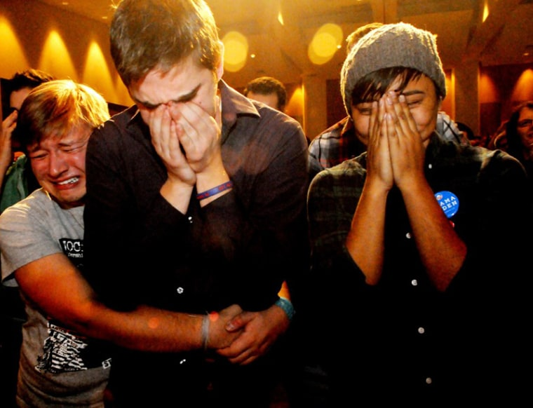 Anthony Streiff, Alex Sand and Nam Dorjee, all of Minneapolis, in tears upon learning voters rejected a proposed amendment to Minnesota's Constitution to ban gay marriage. (Jean Pieri/AP Photo)