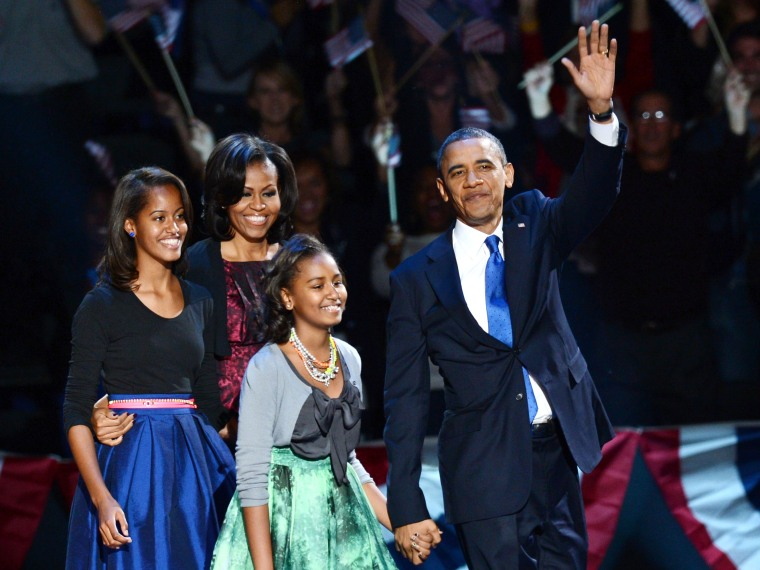 U.S. President Barack Obama and family arrive on stage after winning the 2012 US presidential election November 7, 2012 in Chicago, Illinois.  Obama swept to re-election, forging history again by defying the dragging economic recovery and high...