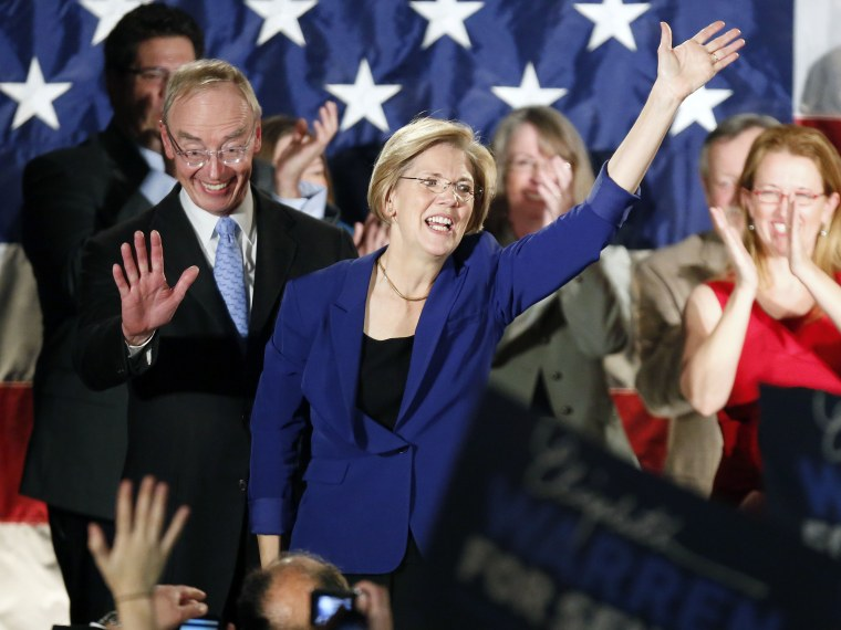 Democrat Elizabeth Warren, center, waves to the crowd with her husband Bruce Mann, left,  during an election night rally at the Fairmont Copley Plaza hotel in Boston after Warren won. (Photo by AP Photo/Michael Dwyer)