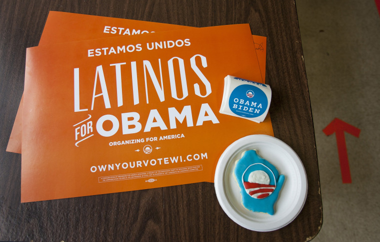Placards and campaign stickers sit on a table at the Latino regional headquarters for the Obama campaign during election day of the U.S. presidential election in Milwaukee, Wisconsin November 6, 2012. (Photo by REUTERS/Sara Stathas)