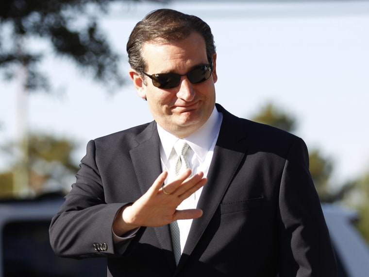 Republican candidate for U.S. Senate Ted Cruz waves as he arrives at a polling station to speak to media and voters in Dallas, Thursday, Nov. 1, 2012. (AP Photo/LM Otero)