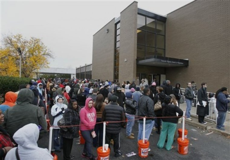Voters wait hours in long lines to cast their early vote at the Summit County Board of Elections on Monday, Nov. 5, 2012, in Akron, Ohio. About 30 million people have already voted in 34 states and the District of Columbia, either by mail or in person....