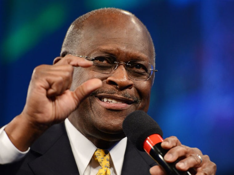 Former candidate for the Republican nomination in the 2012 US presidential election Herman Cain speaks at a Tea Party Unity Rally at The River at Tampa Bay Church in Tampa, Florida. (AFP PHOTO / ROBYN BECK)