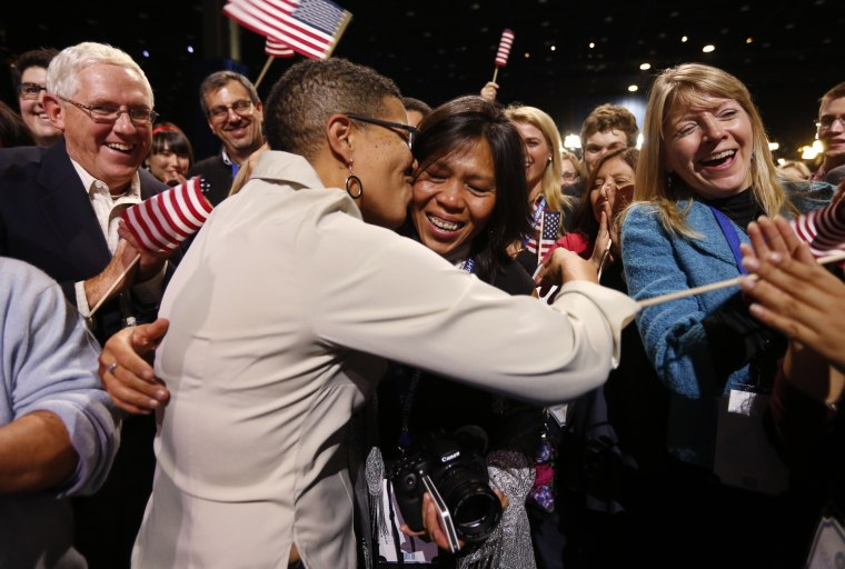 Keesha Patterson of Ft. Washington, Maryland (L) kisses her girlfriend Rowan Ha (R) after proposing marriage, during the election night victory rally at re-elected President Barack Obama headquarters in Chicago. (Photo: REUTERS/Kevin Lamarque)