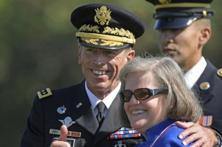 FILE - In this Aug. 31, 2011 file photo, former Commander of International Security Assistance Force and U.S. Forces-Afghanistan Gen. Davis Petraeus, standing with his wife Holly, participates in an armed forces farewell tribute and retirement ceremony...