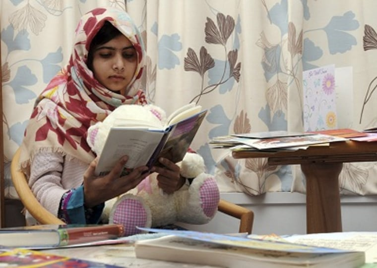 Malala Yousufzai seen reading during her recovery at a hospital in Birmingham, England. (Queen Elizabeth Hospital/AP Photo)