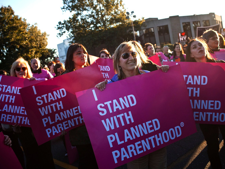 Women protest for continued funding of Planned Parenthood outside Hofstra University prior to the second presidential debate on October 16, 2012 in Hempstead, New York. U.S. President Barack Obama and Republican presidential candidate Mitt Romney will...