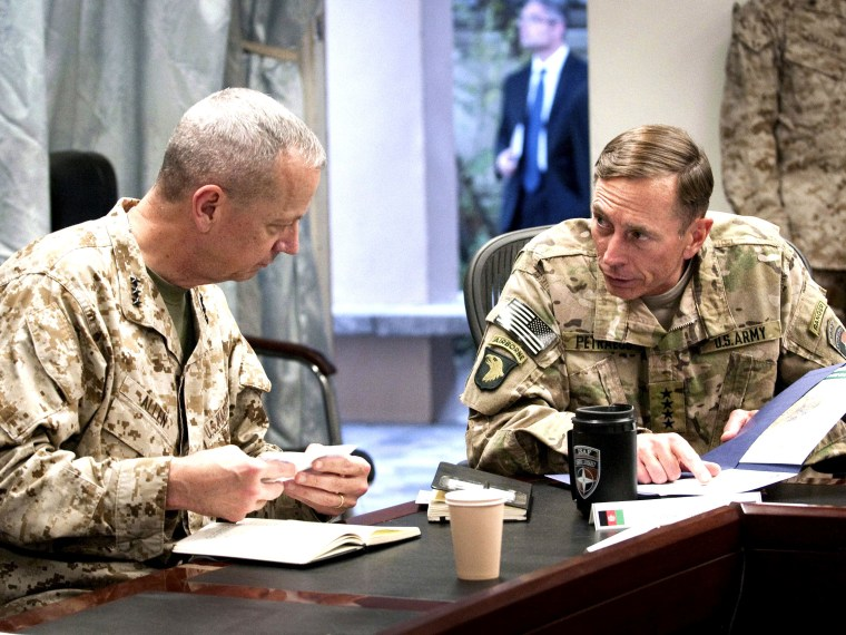 File Photo: General John R. Allen (L), incoming commander, International Security Assistance Force (ISAF)/U.S. Forces- Afghanistan (USFOR-A) and General David H. Petraeus, commander, ISAF/USFOR-A, attend a meeting in Kabul, Afghanistan in this July 9,...