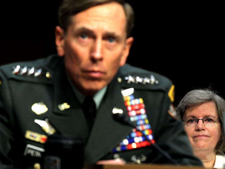 File Photo: U.S. Gen. David Petraeus (L) listens as his wife Holly Petraeus (R) looks on during a confirmation hearing before the Senate (Select) Intelligence Committee June 23, 2011 on Capitol Hill in Washington, DC. (Photo by Alex Wong/Getty Images)