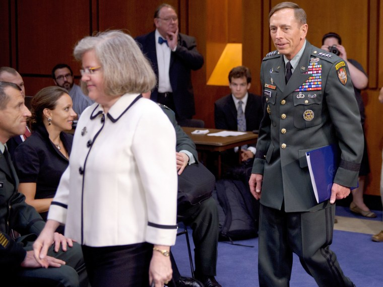 File Photo: A June 23, 2011 photo shows Paula Broadwell (2nd L) watching as General David Petraeus (R) and his wife Holly Petraeus (3rd L) arrive for a Senate Select Intelligence Committee hearing on Petraeus' nomination to be director of the Central...