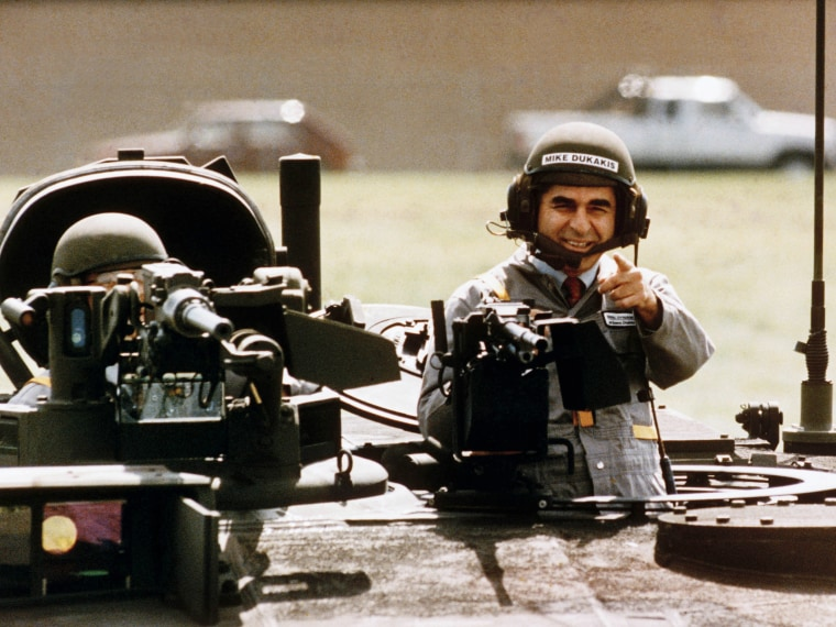 A Sept. 13, 1988 AP Photo of presidential candidate Michael Dukakis taking a ride on a new tank confirmed the perception that liberal candidates were not as militarily strong as their Republican counterparts. ( Photo by Michael E. Samojeden/AP Photo/FILE)