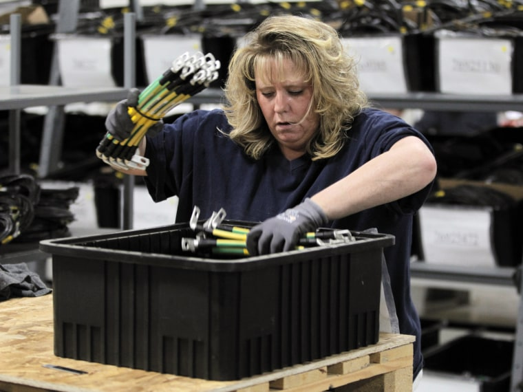 Renee Orriz sorts cables used in wind turbines, inside the production area at the Walker Components factory, in Denver. One-third of the workers at the factory have been laid off this year. Orders are down, and the wind energy boom touted by President...