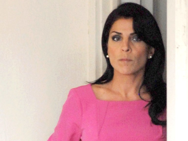 Jill Kelley leaves her home on November 13 in Tampa, Fla. Kelley reported receiving harassing emails to the FBI, which resulted in an investigation that revealed an affair between Paula Broadwell and CIA Director David Petraeus.  (Photo by Tim Boyles...