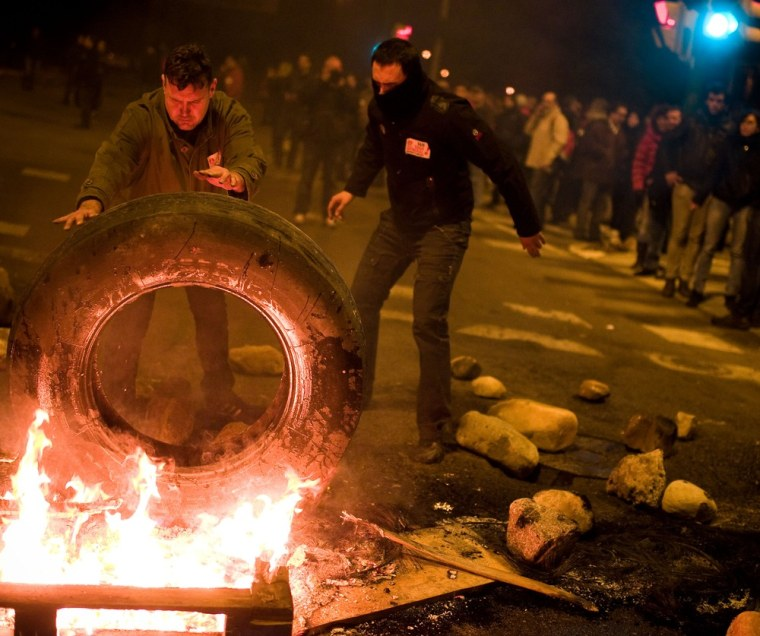 Demonstrators set up a barricade of burning tires at the main entrance of Mercabarna, the biggest wholesale market in the city, at the beginning of a 24-hour strike on November 14, 2012 in Barcelona, Spain.(Photo by David Ramos/Getty Images)