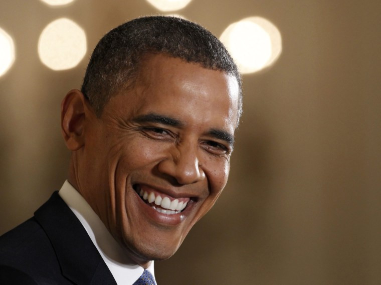 U.S. President Barack Obama smiles while addressing his first news conference since his reelection, at the White House in Washington November 14,  2012.  (Photo by Kevin Lamarque/Reuters)