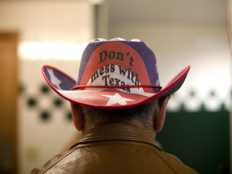 File Photo: Conservative supporters gather at the Victory Texas and Republican Party of Texas election night watch party for Republican Gov. Rick Perry, at the Texas Disposal Systems Exotic Game Ranch on November 2, 2010 in Buda, Texas. Gov. (Photo by...