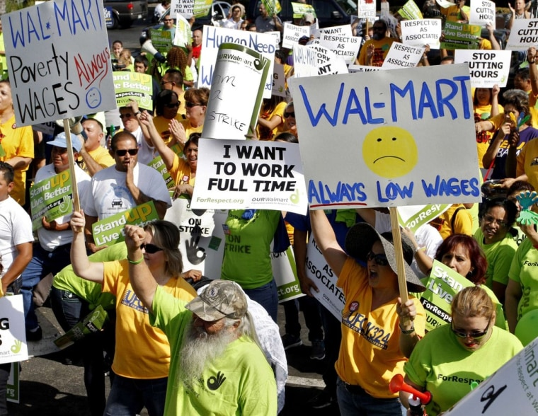 Striking Walmart workers gather during a rally to protest unsafe working conditions and poor wages outside a Walmart store in Pico Rivera, California, October 4, 2012. (REUTERS/Jonathan Alcorn)