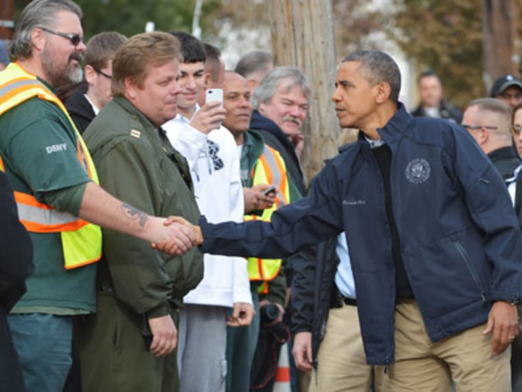 President Obama greeting workers on New York City's Staten Island on Thursday. (Ngan Mandel/AFP Photo)