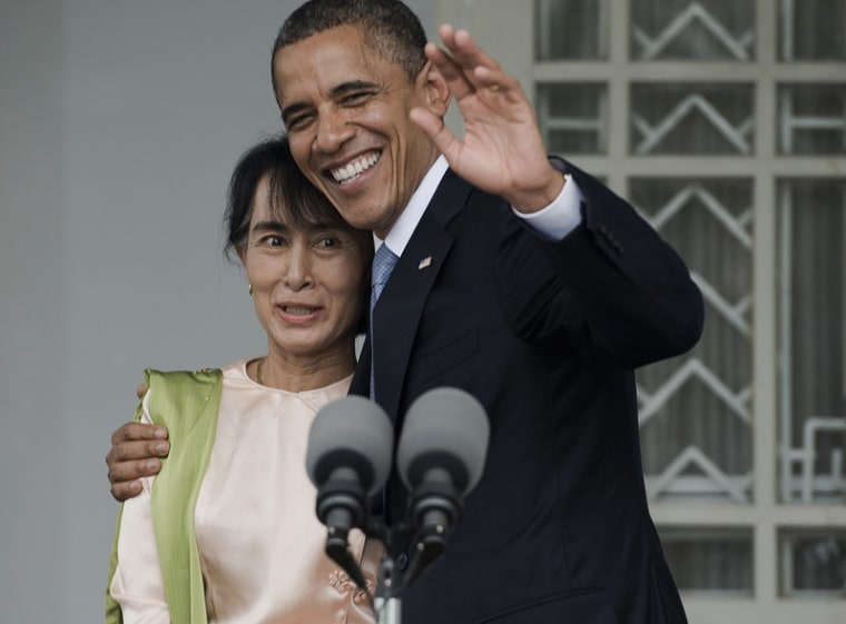 President Barack Obama and Myanmar pro-democracy leader Aung San Suu Kyi speak to the media during a brief joint press conference at her residence in Yangon, on November 19. (Photo by Nicolas Asfouri/AFP - Getty Images)