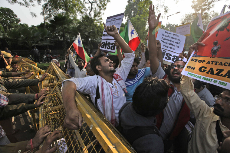 Protesters from various student unions shout slogans during a protest outside the Israeli Embassy in New Delhi, India, Monday, Nov. 19, 2012. The protest was against the Israeli military operations in Gaza Strip. (AP Photo/Manish Swarup)