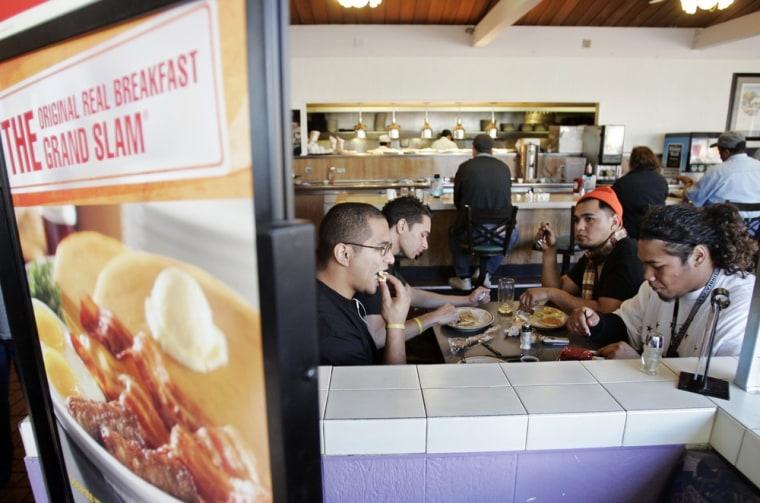 Customers eat a free Grand Slam breakfast at a Denny's restaurant in Sunnyvale, Calif., Tuesday, Feb. 3, 2009. (AP Photo/Paul Sakuma)