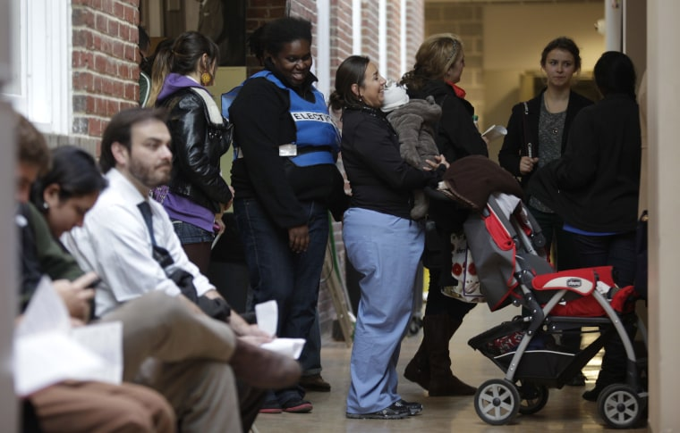 Voters line up to cast their votes during the U.S. presidential election at the School Without Walls polling station in Washington, November 6, 2012. (Photo by Yuri Gripas/Reuters)