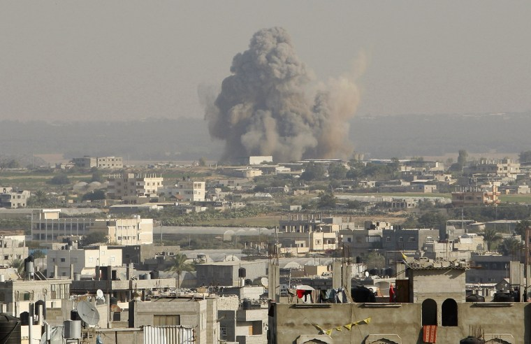 Smoke rise after what witnesses said was an Israeli air strike in Rafah in the southern Gaza Strip November 20, 2012. The U.N. chief called for an immediate ceasefire in the Gaza Strip on Tuesday and U.S. Secretary of State Hillary Clinton headed to...
