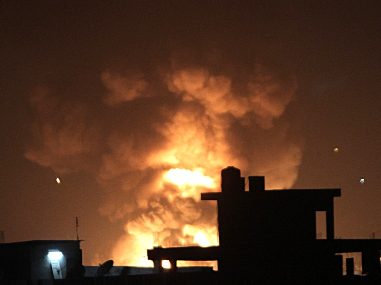 Fire rises during an explosion following an Israeli strike on the border tunnels between Egypt and Rafah in the southern Gaza Strip on November 20, 2012. US Secretary of State Hillary Clinton vowed to support Israeli security on November 20  while...