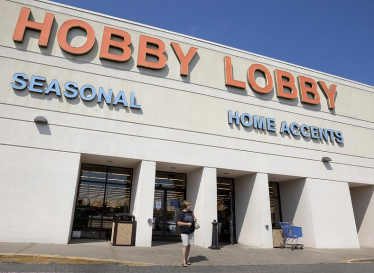 A woman walks from a Hobby Lobby Inc., store in Little Rock, Ark., Wednesday, Sept. 12, 2012. The Oklahoma City-based chain filed a federal lawsuit over a mandate in the health reform law that requires employers to provide coverage for the morning...