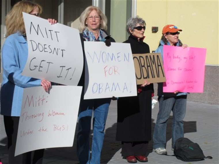 In this Oct. 24, 2012 photo, women backing President Obama protest outside a convention center in Reno where Republican Mitt Romney was giving a campaign speech. (AP Photo/Scott Sonner)