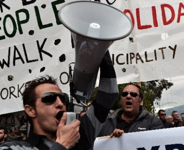 Municipality workers shout slogans during a demonstration outside the Interior Ministry against the new austerity measures in Athens on November 23, 2012. The EU and the International Monetary Fund are working on a compromise to break deadlock on...