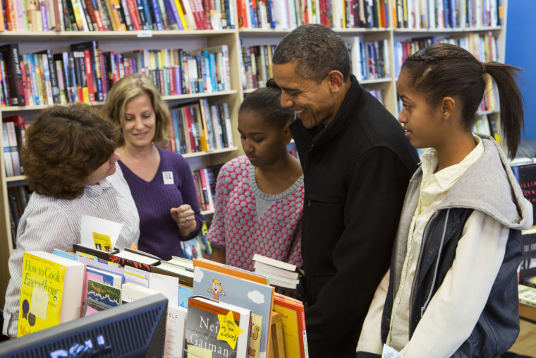 President Barack Obama (2R) and daughters Sasha Obama (C) and Malia Obama (R) shopped at One More Page Books on Small Business Saturday November 24, 2012 in Arlington, Virginia.(Photo by Kristoffer Tripplaar-Pool/Getty Images)