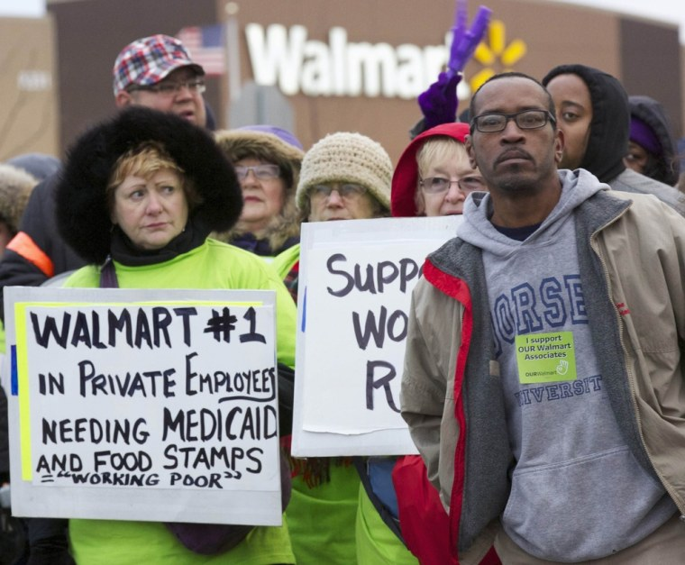 Protesters demonstrate outside a Walmart store in Chicago November 23, 2012. (REUTERS/John Gress)