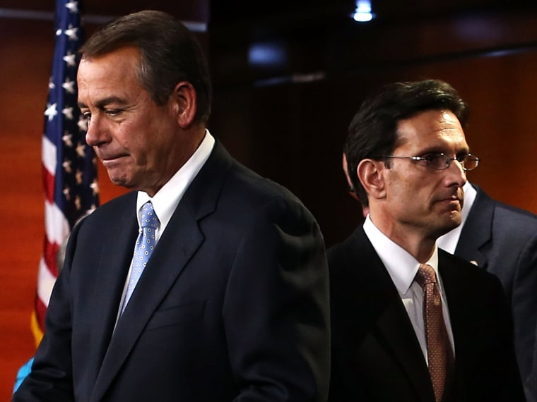 U.S. Speaker of the House Rep. John Boehner (R-OH) (L) and House Majority Leader Rep. Eric Cantor (R-VA) (R) arrive at a news conference to introduce the new House Republican leadership for the next Congress November 14, 2012 on Capitol Hill in...
