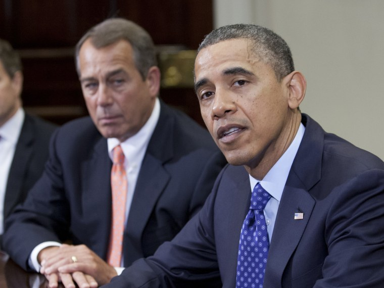 US President Barack Obama speaks before Speaker John Boehner and other cabinet members about the fiscal cliff. (Toby Jorrin / AFP)