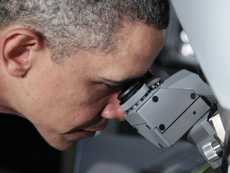 File Photo: President Barack Obama looks through a transmission electron microscope as he tours a semiconductor manufacturing facility at the Intel Corporation in Hillsboro, Ore., Friday, Feb. 18, 2011.  (Photo by Carolyn Kaster/AP Photo)
