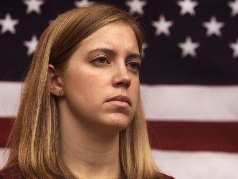 Plaintiff Zoe Bedell, who is a Captain in the U.S. Marine Corps reserves, listens during a media conference Tuesday, Nov. 27, 2012, in San Francisco. Several active women military personnel have filed a federal lawsuit to demand combat action,...