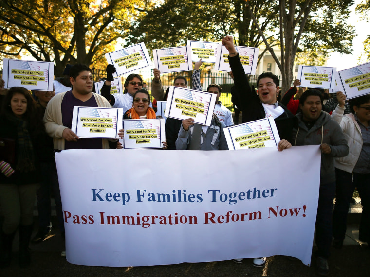 Latinos and immigrants participate in a rally on immigration reform in front of the White House on Nov. 8, 2012, in Washington, D.C. (Photo by Mark Wilson/Getty Images)