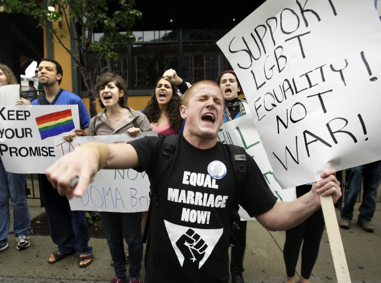 File Photo: Keegan O'Brien of Worcester, Mass., leads chants as members of the LGBT (lesbian, gay, bisexual, transgender) community protest the Defense of Marriage Act outside a Democratic National Committee fundraiser at which Vice President Joe Biden...