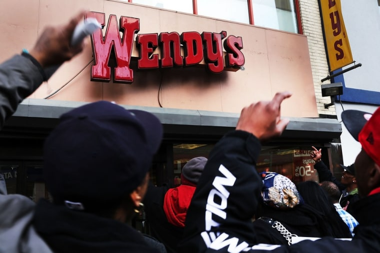 Protesters, many of them employees at Wendy's fast-food restaurant, demonstrate outside of one of the restaurants to demand higher pay and the right to form a union on November 29, 2012 in New York City.   (Photo by Spencer Platt/Getty Images)