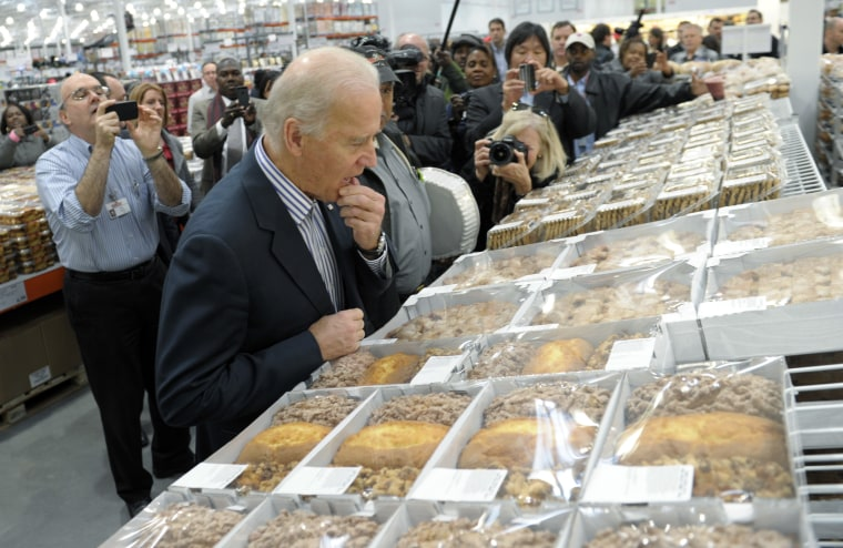 Vice President Joe Biden looks over a selection of items in the bakery section while shopping at a Costco in Washington, Thursday, Nov. 29, 2012 (Photo: AP/Susan Walsh)