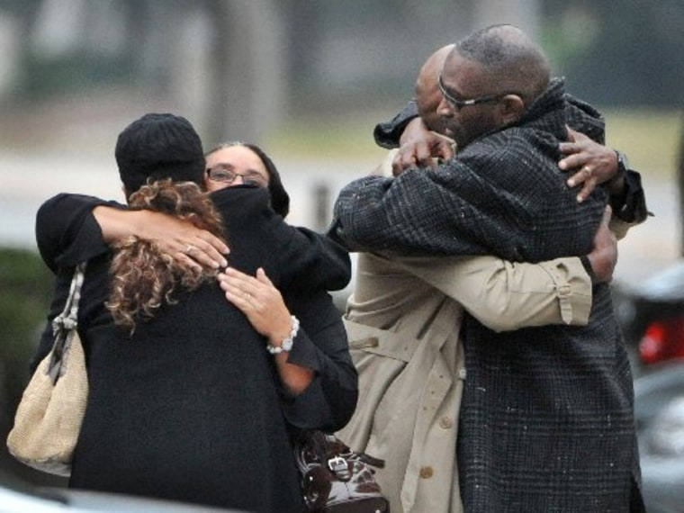 Ron Davis, the father of Jordan Davis is embraced as he arrives at the funeral home for the visitation and a memorial service for his son Jordan, Wednesday, Nov. 28, 2012 in Jacksonville, Fla.(Photo by Bob Self/AP Photo/The Florida Times-Union)