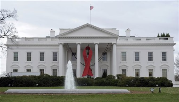The White House in Washington is decorated with a red ribbon to commemorate World Aids Day, Tuesday, Nov. 30, 2010. (AP Photo/Susan Walsh)
