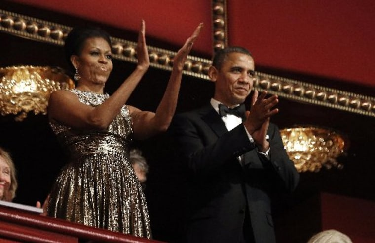 U.S. President Barack Obama and first lady Michelle Obama applaud on the balcony as they attend the 2012 Kennedy Center Honors at the Kennedy Center in Washington, December 2, 2012.     (Photo: Reuters/Jason Reed)