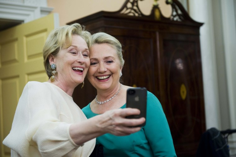 """Actress Meryl Streep and Secretary of State Clinton show that no one's too cool for iPhone """"selfies"""" at the State Department Dinner for the Kennedy Center Honors gala. (AP Photo/Kevin Wolf)"""