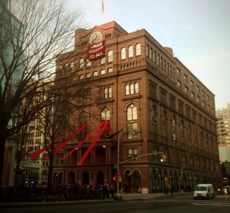 """On December 3, 2012, students at New York's Cooper Union occupied one of the school's buildings and hung a banner reading, \""""FREE EDUCATION FOR ALL.\"""" (Photo courtesy of Free Cooper Union)"""